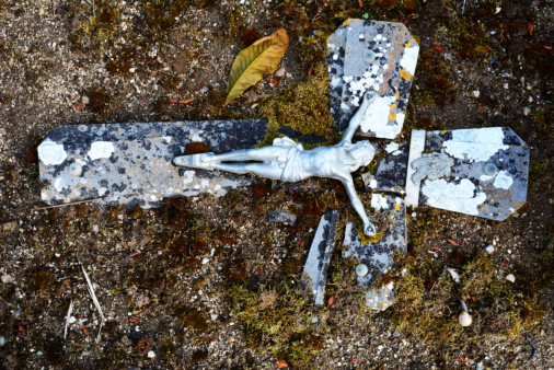 Jesus on old and weathered broken cross